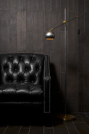 Lincoln tufted armchair in black leather with Stan floor lamp