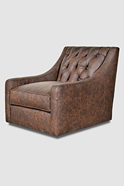Lincoln tufted back armchair with swivel base and cushion seat in Saloon Texas leather