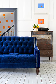 Lincoln tufted loveseat in Cannes Lapis blue velvet with nail head trim
