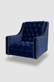 Lincoln armchair with tufted seat in Como Indigo with brass nail head trim and brass legs