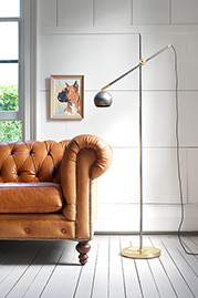 Stan floop lamp and our Higgins Chesterfield sofa