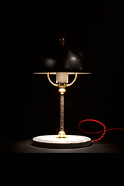 Hopper in mixed metal with white marble base and red cord