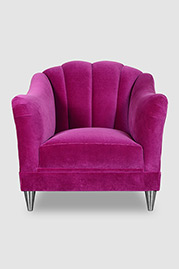 Carla channel-tufted camel back armchair with chrome legs and Como Fuchsia velvet fabric