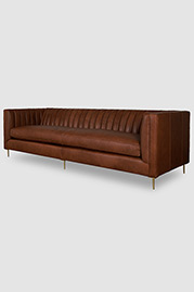 Harley channel-tufted shelter arm sofa in Dakota Sycamore leather with bench cushion and brushed brass stilleto legs