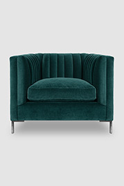 Harley channel-tufted shelter arm chair in Henry Peacock velvet with stainless steel legs