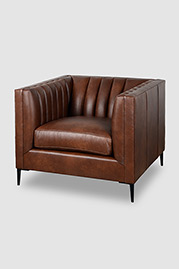 Harley channel-tufted armchair in tough-wearing Dante Bourbon leather with black metal legs