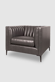 Harley channel-tufted shelter arm chair in Chiaro Greyhound leather with black metal legs
