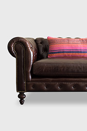 Giant Blanket Bolster pillow on Higgins Chesterfield sofa