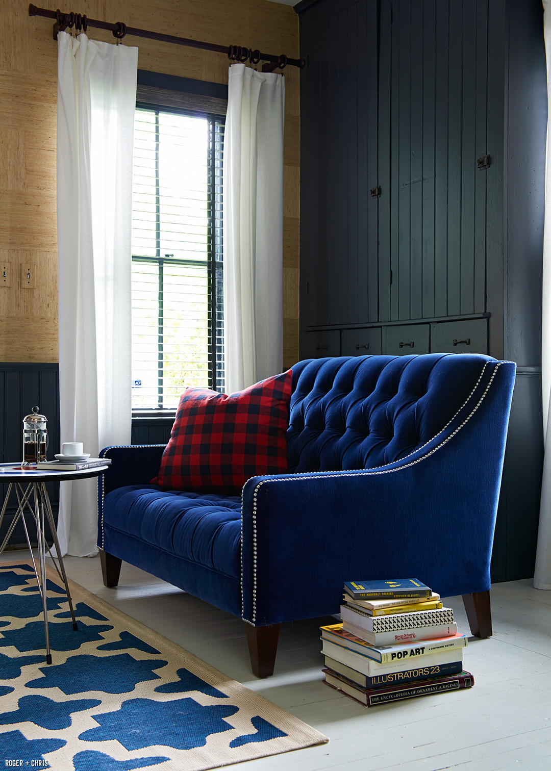 Our tufted Lincoln love seat in blue velvet. Photo by Alec Hemer.