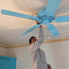 The simple, spray-painted ceiling fan will disappear.