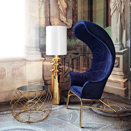 Blue velvet campaign chair