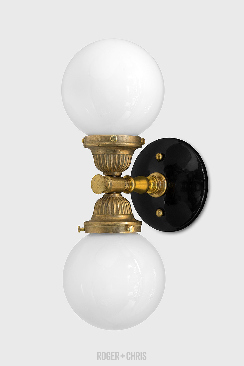 Grand Central solid brass wall sconce with black porcelain wall plate ROGER + CHRIS